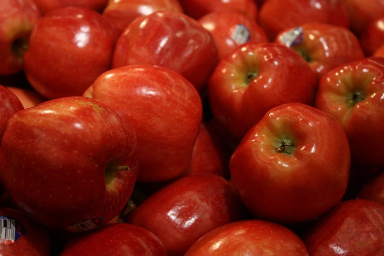 Apples are on display at a grocery store in Atlanta, Georgia. Red fruits like an apple can be some of the healthiest foods to eat. The deeper the color, the more effective they are at helping turn off obesity genes. Studies have shown they can help regulate glucose tolerance and insulin.